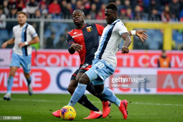 Felipe Caicedo of SS Lazio competes for the ball with Adama Soumaoro of Genoa CFC during the Serie A match between Genoa CFC and SS Lazio at Stadio...