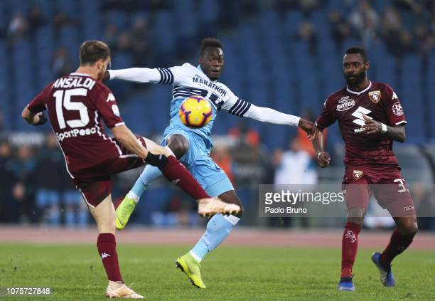 Felipe Caicedo of SS Lazio competes for the ball with Nicolas Nkoulou and Cristian Ansaldi of Torino FC during the Serie A match between SS Lazio and...