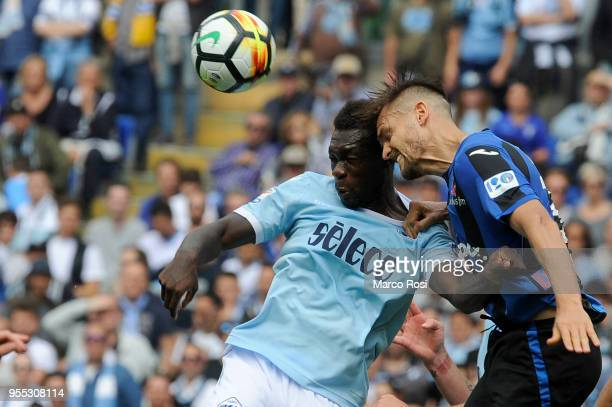 Felipe Caicedo of SS Lazio competes for the ball with Rafael Toloi Atalanta BC during the serie A match between SS Lazio and Atalanta BC at Stadio...