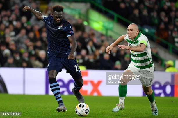 Felipe Caicedo of SS Lazio competes for the ball with Scott Brown of Celtic FC during the UEFA Europa League group E match between Celtic FC and...