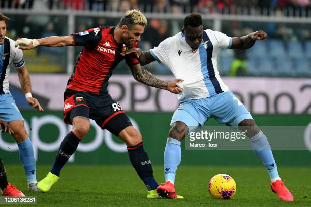 Felipe Caicedo of SS Lazio competes for the ball with Valon Begrami of Genoa CGC during the Serie A match between Genoa CFC and SS Lazio at Stadio...