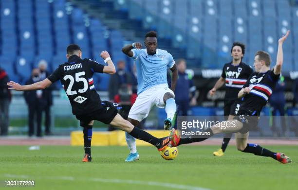 Felipe Caicedo of S.S. Lazio is challenged by Alex Ferrari and Jakub Jankto of U.C. Sampdoria during the Serie A match between SS Lazio and UC...