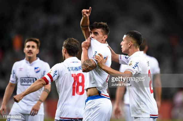 Felipe Carballo of Nacional URU celebrates with teammate Santiago Rodríguez after scoring the first goal of his team during a match between Atletico...