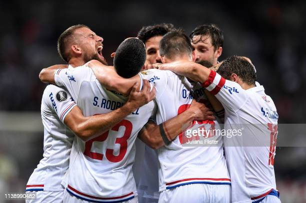 Felipe Carballo of Nacional URU celebrates with teammates after scoring the first goal of his team during a match between Atletico MG and Nacional...