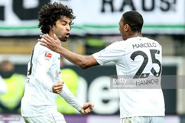 Felipe celebrates his team's second goal with team mate Marcelo of Hannover during the Bundesliga match between Eintracht Frankfurt and Hannover 96...