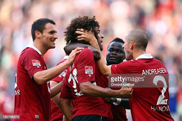 Felipe celebrates the first goal with Mario Eggimann Didier Ya Konan and Leon Andreasen of Hannover during the Bundesliga match between Hannover 96...