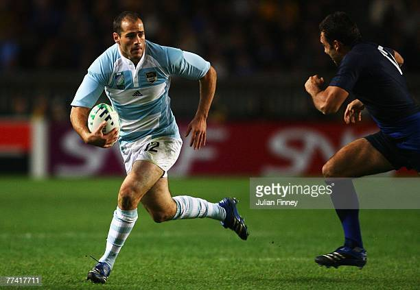 Felipe Contepomi of Argentina takes on David Marty of France during the Bronze Final of the Rugby World Cup 2007 between France and Argentina at the...