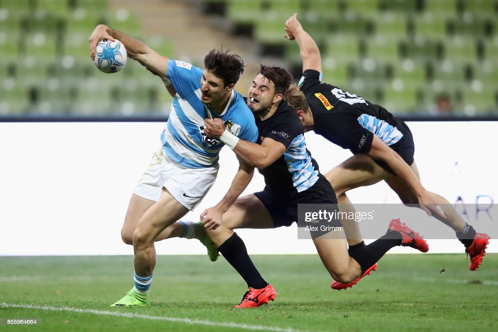 Felipe del Mestre of Argentina scores a try against Fabian Heimpel and Tim Lichtenberg of Germany during the 5th place match between Argentina and Germany on Day 2 of the Rugby Oktoberfest 7s tournament at Olympiastadion on September 30, 2017 in Munich, Germany.