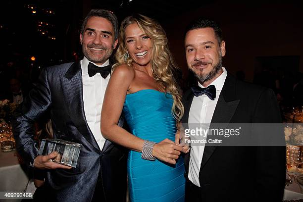 Felipe Diniz Adriane Galisteu and Alexandre Iodice attend the 5th Annual amfAR Inspiration Gala at the home of Dinho Diniz on April 10 2015 in Sao...