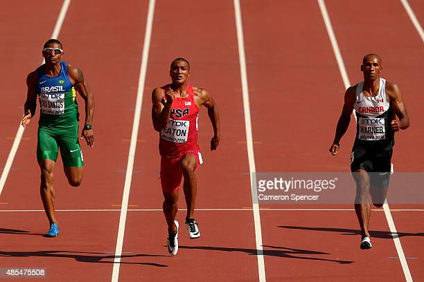 Felipe Dos Santos of Brazil Ashton Eaton of the United States and Damian Warner of Canada compete in the Men's Decathlon 100 metres during day seven...