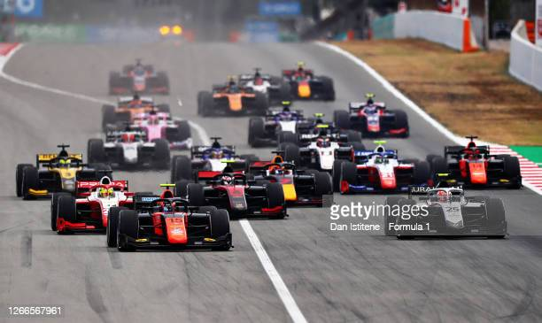Felipe Drugovich of Brazil and MP Motosport leads Luca Ghiotto of Italy and Hitech Grand Prix and the rest of the field at the start during the...