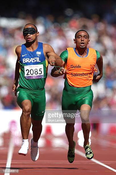 Felipe Gomes and Leonardo Lopes Souza of Brazil compete in the Men's 100m — T11 semi finals on day 10 of the London 2012 Paralympic Games at Olympic...