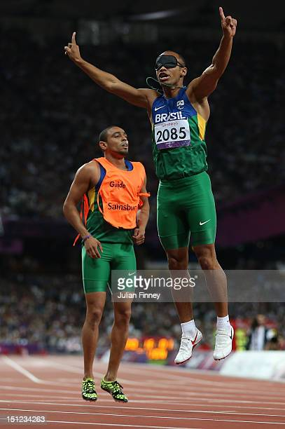 Felipe Gomes of Brazil and his guide Leonardo Souza Lopes celebrate winning the gold in the Men's 200m T11 Final on day 6 of the London 2012...