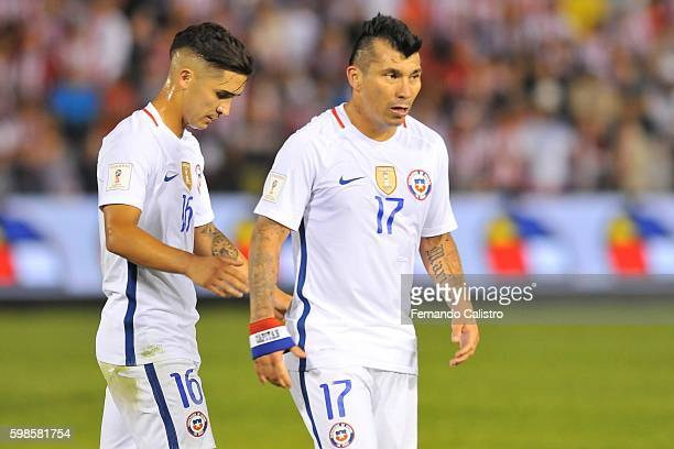 Felipe Guitierrez and Gary Medel of Chile walk out the field during a match between Paraguay and Chile as part of FIFA 2018 World Cup Qualifiers at...