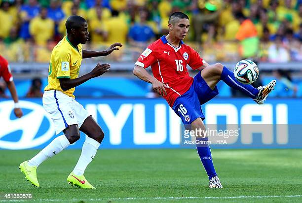 Felipe Gutierrez of Chile and Ramires of Brazil compete for the ball during the 2014 FIFA World Cup Brazil Round of 16 match between Brazil and Chile...