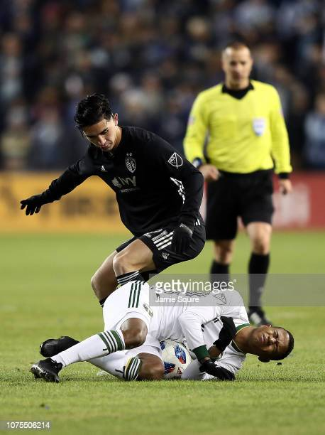 Felipe Gutierrez of Sporting Kansas City fouls Andy Polo of the Portland Timbers during leg 2 of the Conference Championship at Children's Mercy Park...