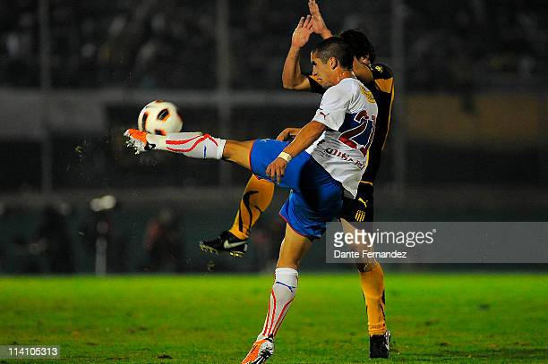 Felipe Gutierrez of Universidad Catolica runs for the ball during a match as part of the Santander Libertadores Cup 2011 at the Centenary Stadium on...
