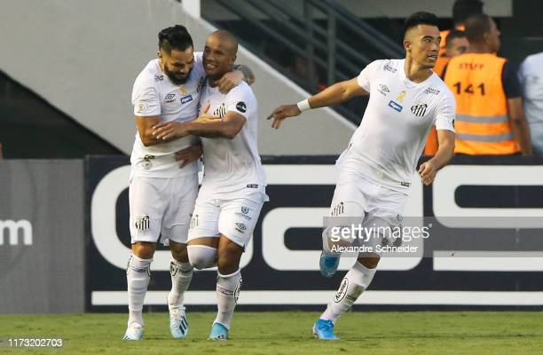 Felipe Jonatan, Carlos Sanchez and Uribe celebrate their first goal during the match against Athletico PR for the Brasileirao Series A 2019 at Vila...