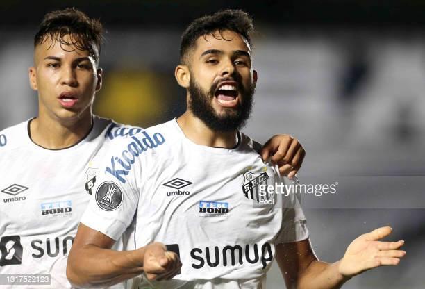 Felipe Jonatan of Santos celebrates with teammate Kaio Jorge after scoring the first goal of his team during a match between Santos and Boca Juniors...