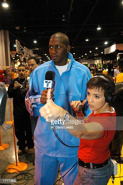 Felipe Lopez and Claudia Trejos host of the Telemundo program NBA Max wait to live during the 2003 NBA AllStar Weekend Jam Session on February 8 2003...