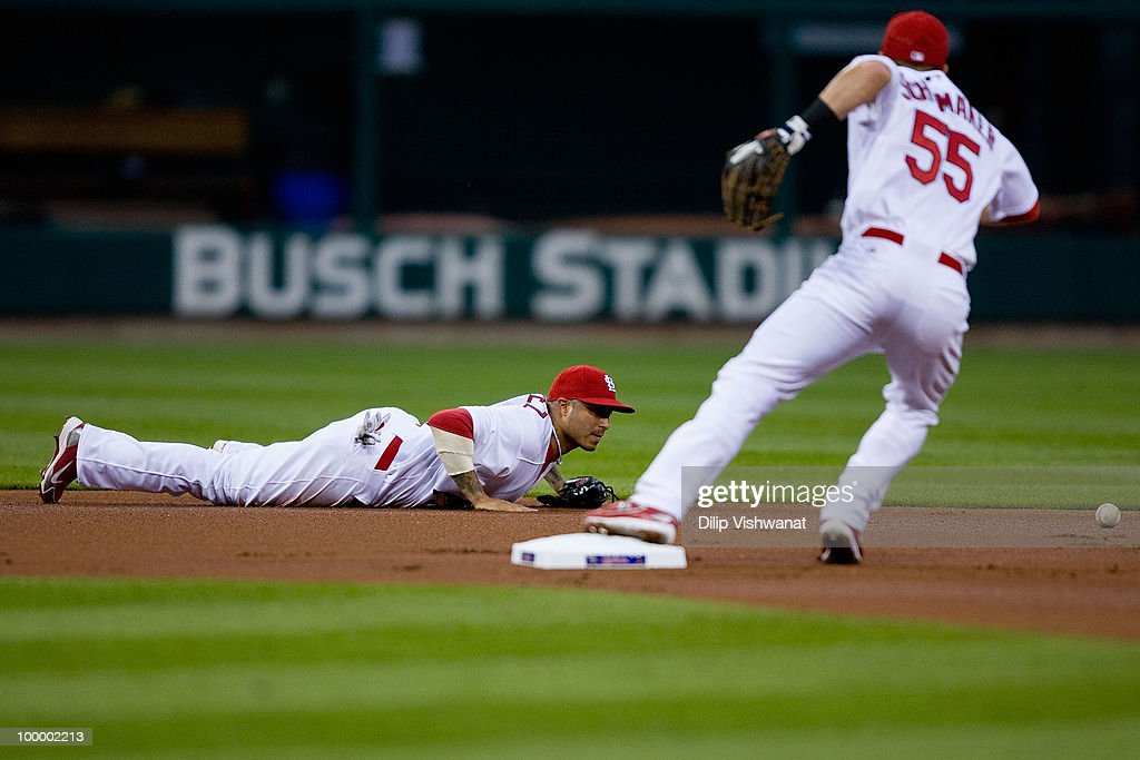 Felipe Lopez #3 of the St. Louis Cardinals attempts to field a ground ball against the Florida Marlins at Busch Stadium on May 19, 2010 in St. Louis, Missouri. The Marlins beat the Cradinals 5-1.