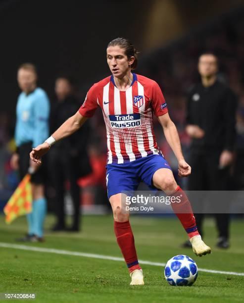Felipe Luis of Club Atletico de Madrid runs controls the ball during the UEFA Champions League Group A match between Club Atletico de Madrid and AS...