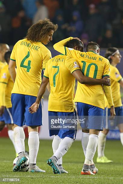 Felipe Luiz Douglas Costa and Neymar of Brazil leave the field after the 2015 Copa America Chile Group C match between Brazil and Peru at Municipal...