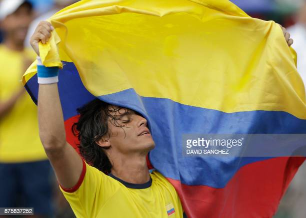 Felipe Mantilla of Colombia celebrates after winning the gold medal in the men's individual final tennis match against Roberto Quiroz of Ecuador...