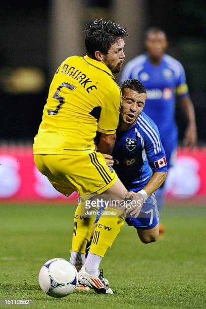 Felipe Martins of the Montreal Impact collides with Danny O'Rourke of the Columbus Crew and loses control of the ball in the second half on September...