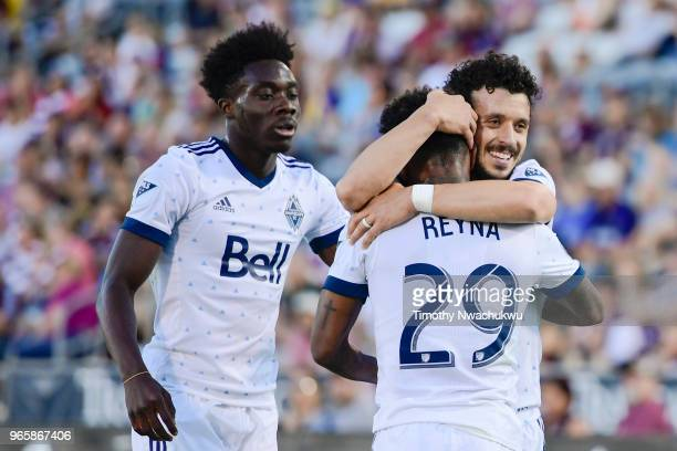 Felipe Martins of Vancouver Whitecaps embraces teammate Yordi Reyna after Reyna scored in the first half against the Colorado Rapids at Dick's...