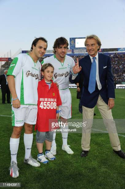 Felipe Massa, Fernando Alonso and Luca Cordero di Montezemolo attends the XX Partita Del Cuore charity football game at Stadio Ennio Tardini on May...