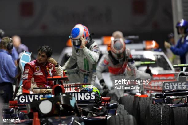 Felipe Massa, Jenson Button, Heikki Kovalainen, Ferrari F2008, Grand Prix of Singapore, Marina Bay Street Circuit, 28 September 2008. An exhausted...