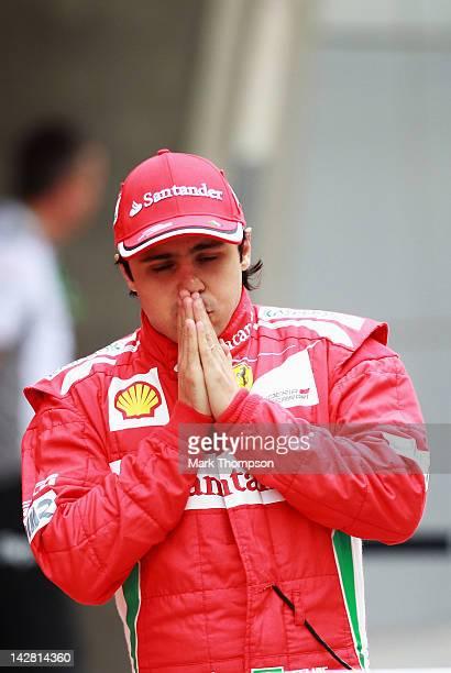 Felipe Massa of Brazil and Ferrari attends the Ferrari team group photo opportunity before the start of practice for the Chinese Formula One Grand...
