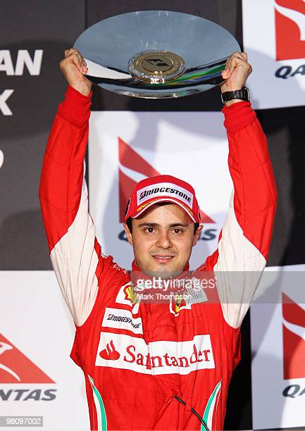 Felipe Massa of Brazil and Ferrari celebrates finishing third during the Australian Formula One Grand Prix at the Albert Park Circuit on March 28,...