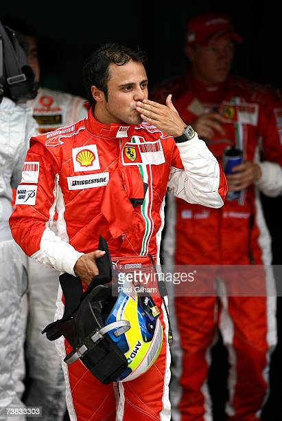 Felipe Massa of Brazil and Ferrari celebrates securing pole position in qualifying for the Malaysian Formula One Grand Prix at the Sepang Circuit on...