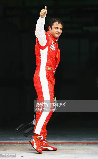 Felipe Massa of Brazil and Ferrari celebrates taking pole position during qualifying for the Malaysian Formula One Grand Prix at the Sepang Circuit...