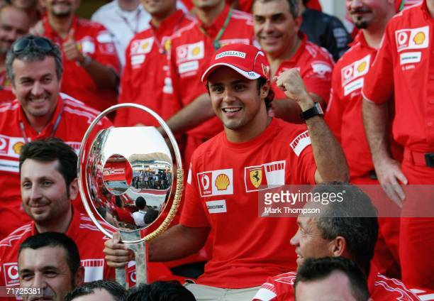 Felipe Massa of Brazil and Ferrari celebrates with his teammates after winning the Turkish Formula One Grand Prix at the Istanbul Park on August 27...