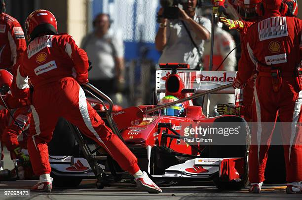 Felipe Massa of Brazil and Ferrari comes in for a pitstop during the Bahrain Formula One Grand Prix at the Bahrain International Circuit on March 14,...