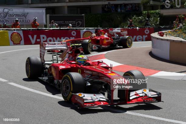 Felipe Massa of Brazil and Ferrari drives ahead of team mate Fernando Alonso of Spain and Ferrari during the final practice session prior to...