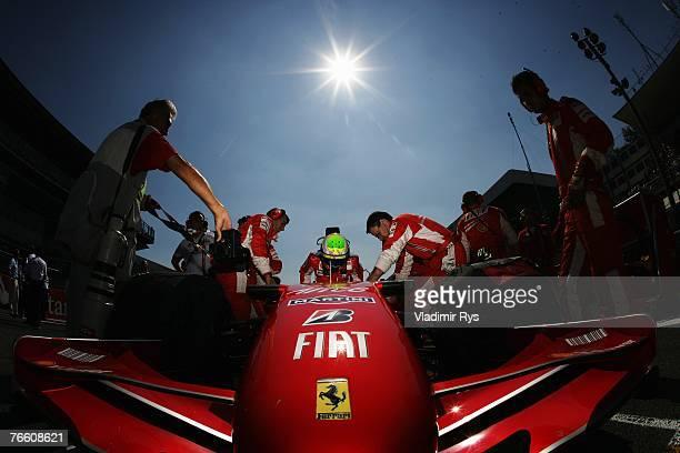 Felipe Massa of Brazil and Ferrari gets into his car before the Italian Formula One Grand Prix at the Autodromo Nazionale di Monza on September 9,...
