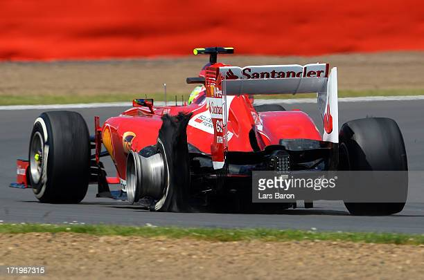 Felipe Massa of Brazil and Ferrari has a left rear puncture on his tyre during the British Formula One Grand Prix at Silverstone Circuit on June 30...