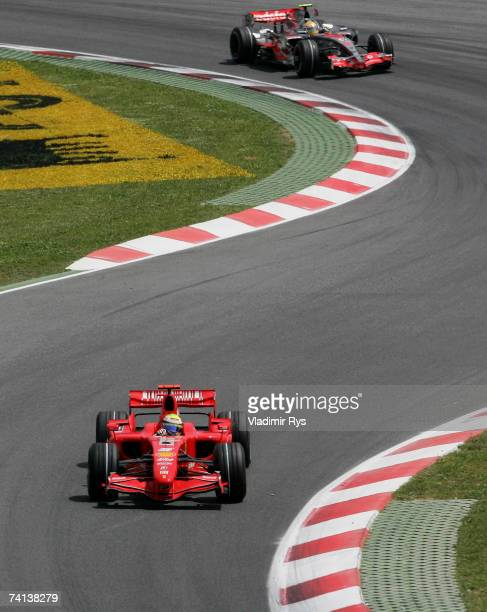 Felipe Massa of Brazil and Ferrari in action followed by Lewis Hamilton of Great Britain and McLaren Mercedes during the Spanish Formula One Grand...