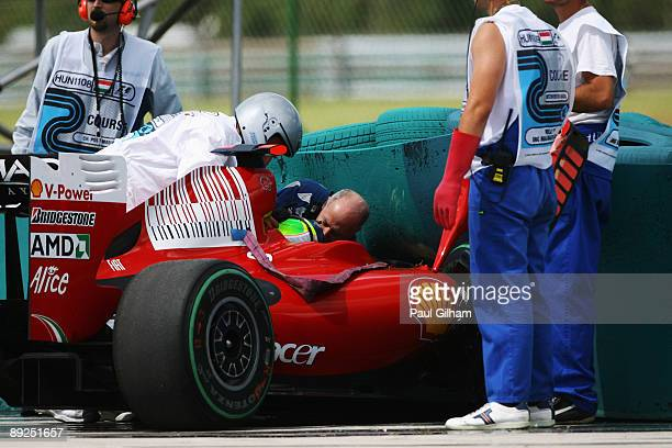 Felipe Massa of Brazil and Ferrari is attended to by Gary Hartstein medical staff and marshalls following his accident during qualifying for the...