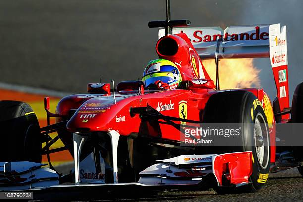 Felipe Massa of Brazil and Ferrari is seen in action with flames coming from the rear of the car during day three of winter testing at the Ricardo...
