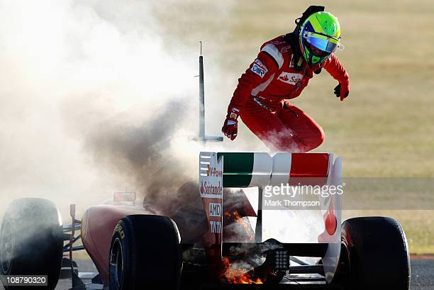 Felipe Massa of Brazil and Ferrari jumps out of his car following an engine problem during day three of winter testing at the Ricardo Tormo Circuit...