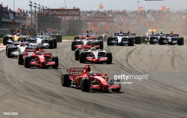 Felipe Massa of Brazil and Ferrari leads the pack into the first corner during the F1 Grand Prix of Turkey at Istanbul Park on August 26 in Istanbul,...
