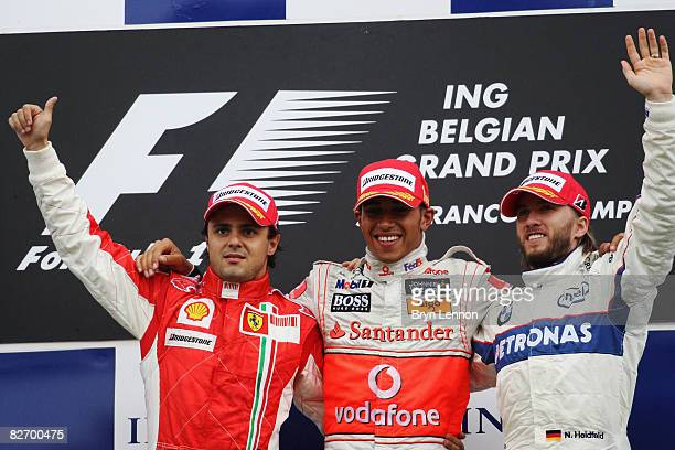 Felipe Massa of Brazil and Ferrari, Lewis Hamilton of Great Britain and McLaren Mercedes and Nick Heidfeld of Germany and BMW Sauber celebrate on the...