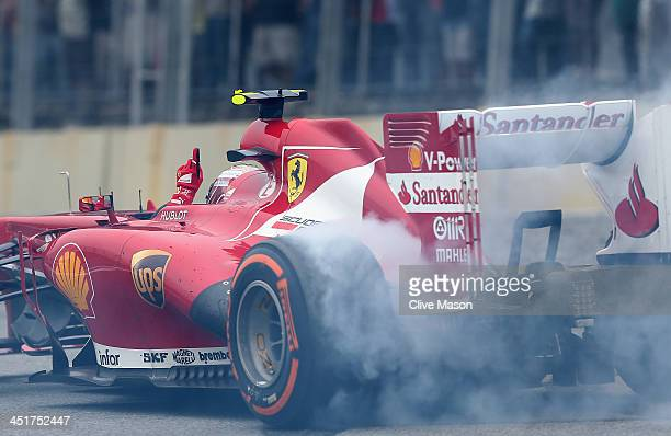 Felipe Massa of Brazil and Ferrari performs donuts as he finishes his last race for Ferrari following the Brazilian Formula One Grand Prix at...