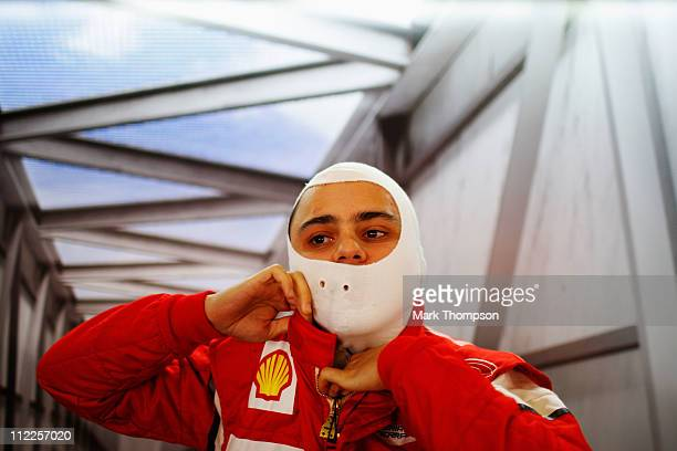 Felipe Massa of Brazil and Ferrari prepares to drive during the final practice session prior to qualifying for the Chinese Formula One Grand Prix at...