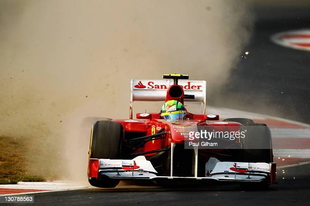 Felipe Massa of Brazil and Ferrari rides over the kerbs during the Indian Formula One Grand Prix at the Buddh International Circuit on October 30,...